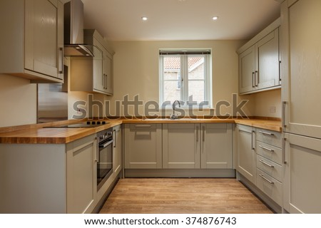 Fitted kitchen with built-in appliances - stock photo