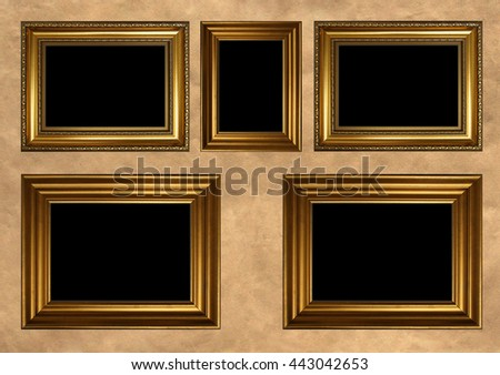 Five antique golden frames with black copy space on vintage background - stock photo