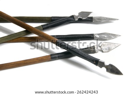 Five antique old wooden arrows isolated on a white backgroundarrows - stock photo