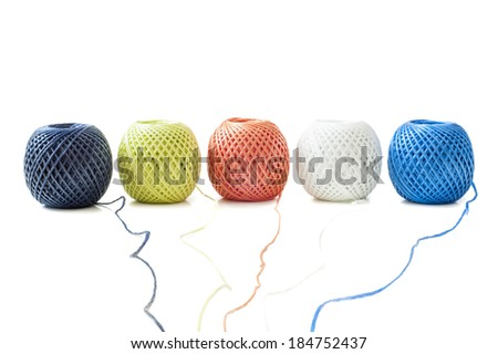 Five ball of twine on a white background - stock photo