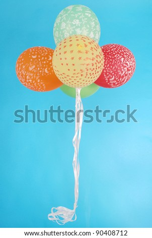five balloons on blue background - stock photo