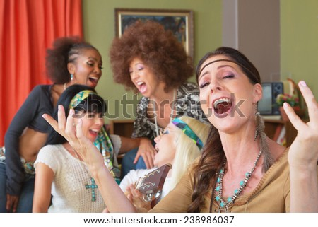 Five beautiful mature singing women in 1960s clothing - stock photo