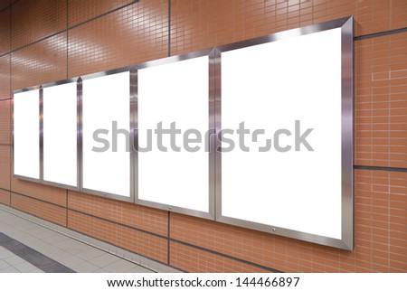 Five big vertical / portrait orientation blank billboard on brown wall - stock photo