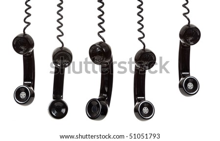 five black hanging telephone receivers on a white background - stock photo