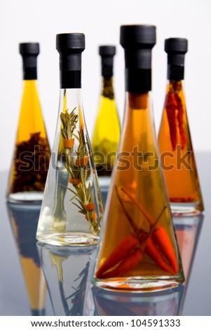 Five bottles of assorted olive oil bottles - stock photo