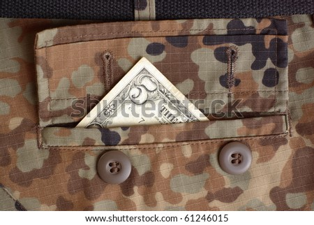 Five bucks in the uniform pocket - stock photo