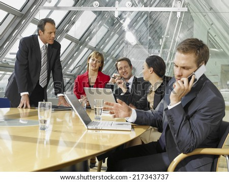 Five business executives in a board room - stock photo