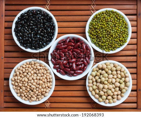 Five colored beans in ceramics bowl - stock photo