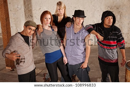 Five cool friends leaning on each other - stock photo