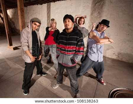 Five cool hip hop dancers strike a pose - stock photo