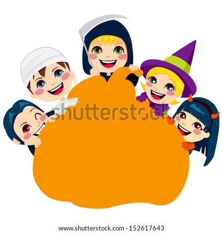 Five cute children in scary monster costumes holding a pumpkin shaped billboard with copy space for text - stock photo