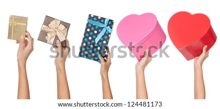 Five different gifts being giving out from an extended arm isolated on white. - stock photo
