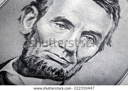 Five dollars banknote close up, with selective focus on eyes - stock photo