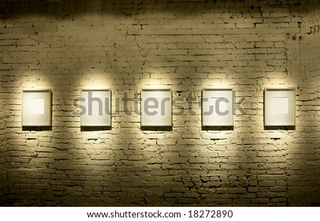 Five frames on brick wall - stock photo