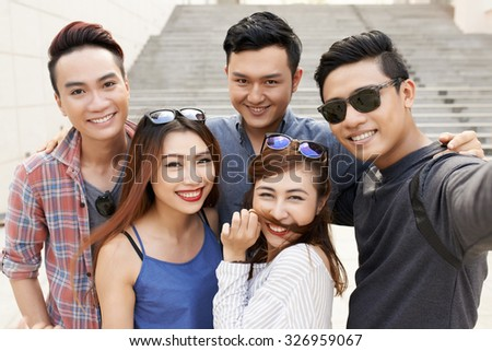 Five friends posing to take self portrait - stock photo