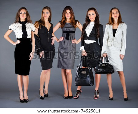 Five girls in spring summer collection clothes - stock photo