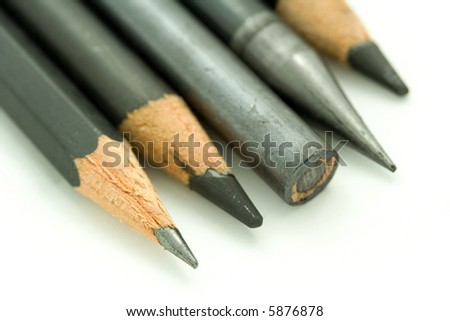 Five graphite pencils. - stock photo