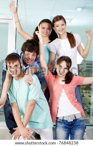 Five happy friends posing before camera - stock photo
