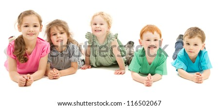 Five happy smiling kids lying in line on floor. On white. - stock photo