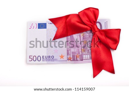 Five hundred euro banknote with a red ribbon as a gift isolated on white background - stock photo