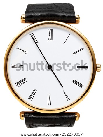 five minutes to five o'clock on dial of wristwatch isolated on white background - stock photo
