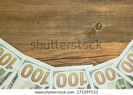 Five New One Hundred Dollar Bill On The Rough Wood Background - stock photo