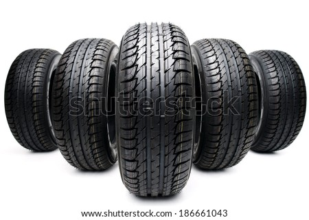 five new tires formation isolated on white photo - stock photo