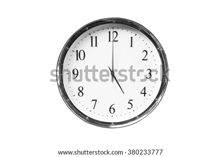 Five o'clock on the white wall clocks (isolated) - stock photo