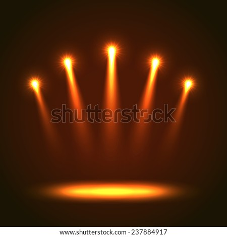 Five orange bright projectors for scene lighting decoration on black background. Special light effects - stock photo