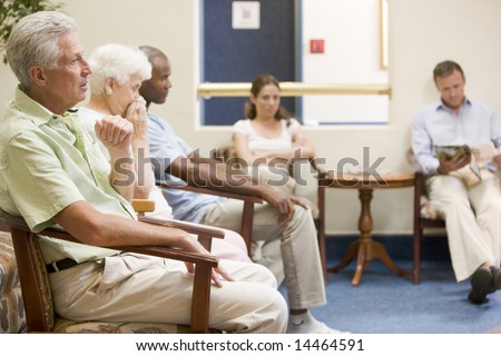 Five people waiting in waiting room - stock photo