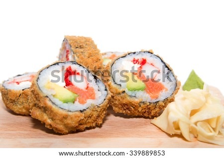 Five pieces of deep-fried Japanese roll with crab meat, salmon, avocado, caviar, crispy breading  isolated on white background - stock photo