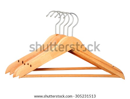 five pour wooden hangers over white background - stock photo
