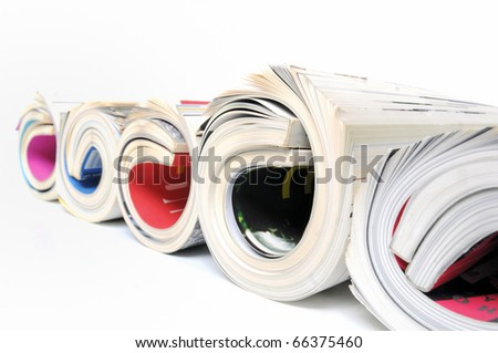 Five rolled up magazines over white background - stock photo