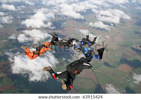 Five skydivers - stock photo