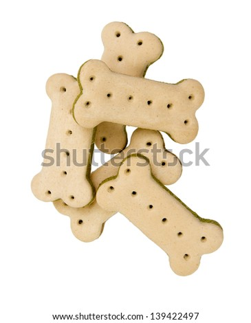 Five small vaguely bone shaped dry food dog treats isolated on white. - stock photo