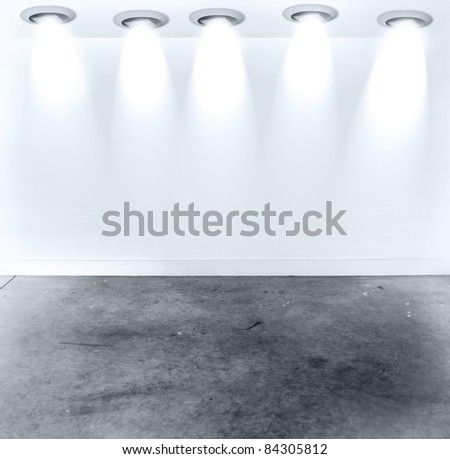 Five spotlights on wall. Copy space - stock photo