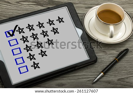 five star rating concept on tablet pc - stock photo