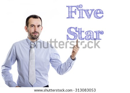 Five Star - Young businessman with small beard pointing up in blue shirt - stock photo