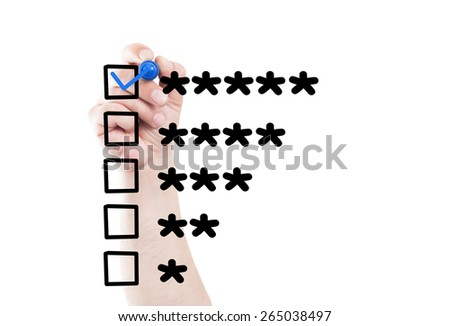 Five stars rating and checkbox draw on transparent white wipe board with a hand holding a marker - stock photo