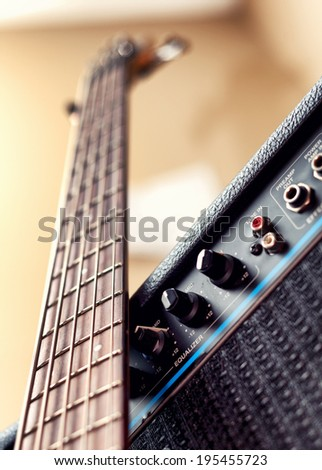five strings bass guitar with an amplifier - stock photo