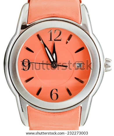 five to twelve o'clock on dial of orange wristwatch isolated on white background - stock photo