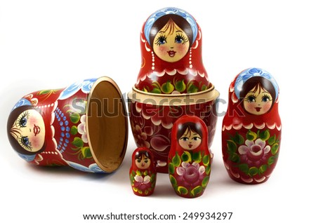 five traditional Russian matryoshka dolls on white background - stock photo