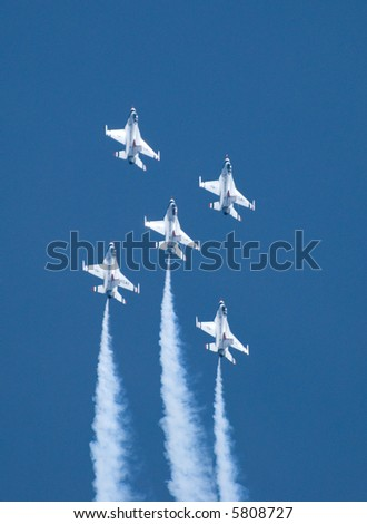 Five US Air Force Thunderbirds flying in formation - stock photo
