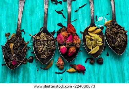 five varieties of loose tea tea spoons - stock photo