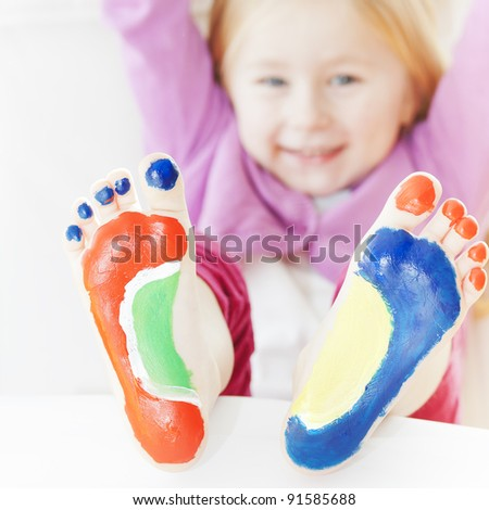 Five year old girl with feet painted.  with focus on feet. See my portfolio for more - stock photo