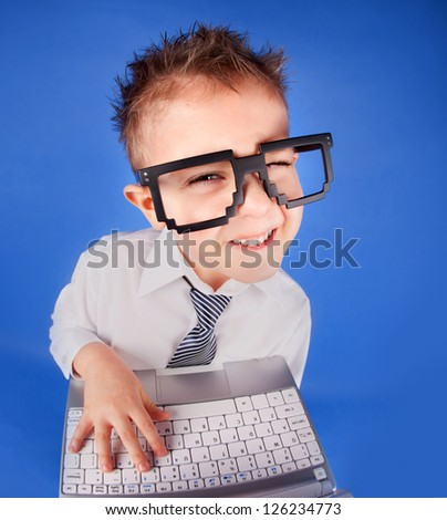 Five years old boy with a laptop computer - stock photo
