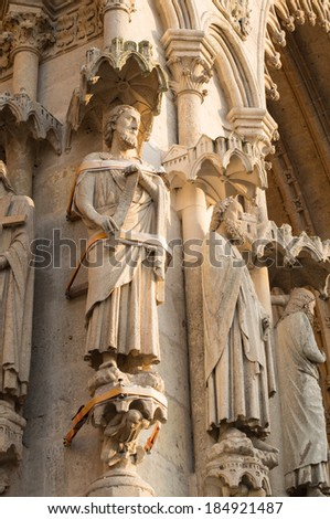 Fixed statue of apostle on the facade of the Notre Dame cathedral in Amiens, France - stock photo
