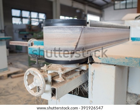 fixed vertical electric belt sander of carpenter in hall - stock photo