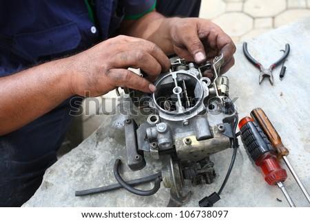 fixing car engine,carburetor. - stock photo