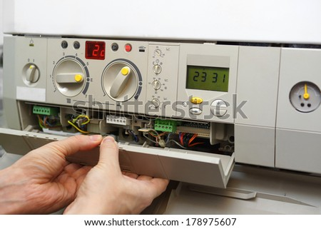 fixing gas furnace - stock photo